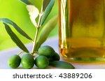 Green olives and oil. - stock photo