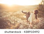 carefree happy woman sitting on ... | Shutterstock . vector #438910492