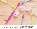 toothbrush and tooth on a... | Shutterstock . vector #438989785