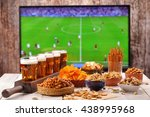 beer and snacks set on football ... | Shutterstock . vector #438995968