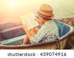 Reading Boy In Old Boat