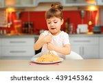 adorable little girl eating... | Shutterstock . vector #439145362