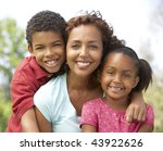 mother with children in park | Shutterstock . vector #43922626