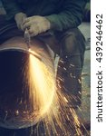 Small photo of Metal cutting with acetylene torch.
