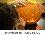 man carving a pumpkin shaped as ... | Shutterstock . vector #439255732