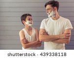 handsome young father and his... | Shutterstock . vector #439338118