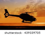 Silhouette Of Helicopter Takin...