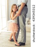 cropped image of young father... | Shutterstock . vector #439345312