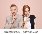 Small photo of Woman and man keep secret. Couple shows hush sign, adultery, relationship issue, marriage cheating concept. Secret love, jealousy. Mystery, privacy, intimacy. Young beautiful couple isolated at pink