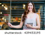 girl texting on the tablet... | Shutterstock . vector #439453195