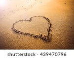 Love Sign Writing On Sand At...