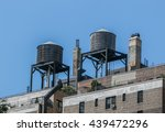 old wooden water tanks on roofs ... | Shutterstock . vector #439472296