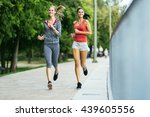 fit women jogging outdoors and... | Shutterstock . vector #439605556