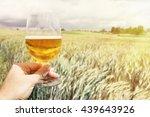 glass of beer in the hand... | Shutterstock . vector #439643926