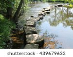 Small photo of Rocky Stepping Stones Across a Beautiful Rural River.