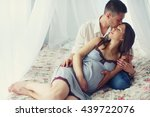 pregnant lady rests in man's... | Shutterstock . vector #439722076
