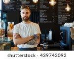 happy barista standing at... | Shutterstock . vector #439742092
