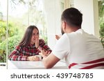 happy young couple is chatting... | Shutterstock . vector #439748785