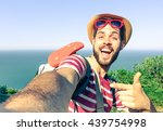 young man taking travel selfie... | Shutterstock . vector #439754998