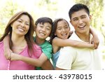 family enjoying day in park   Shutterstock . vector #43978015