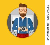 a hipster photographer with the ... | Shutterstock .eps vector #439789168