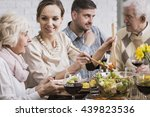smiling woman serving dinner to ... | Shutterstock . vector #439823536