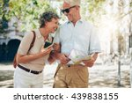 retired couple walking around... | Shutterstock . vector #439838155