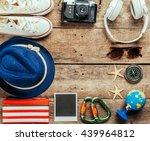 set of trip stuff on wooden... | Shutterstock . vector #439964812