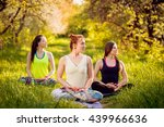 young girls yoga in the park.... | Shutterstock . vector #439966636