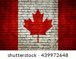 canadian flag on a brick wall.... | Shutterstock . vector #439972648