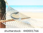 Beach View With White Hat And...
