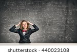 stressed teacher in classroom | Shutterstock . vector #440023108