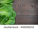 green salad on a dark wood... | Shutterstock . vector #440048242