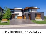 Luxury House At Sunny Day In...