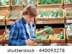 young man in the supermarket ... | Shutterstock . vector #440093278