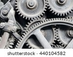 Small photo of Old machinery: gear, metal cogwheels, nuts and bolts. Everything is working fine since a lot of time ago!.