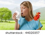 Young Woman Blowing Her Nose....