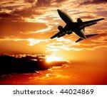 airplane on sunset sky | Shutterstock . vector #44024869