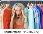 stressed woman deciding what to ... | Shutterstock . vector #440287372