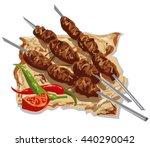tasty kebabs on skewers with... | Shutterstock .eps vector #440290042