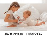 sister explaining and reading... | Shutterstock . vector #440300512