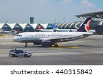 Small photo of Bangkok Thailand 19 june 2016 : The Air macau airways By Airbus A320 - 200 was taxing and The Thai airway controller car was driving at Suwannabhum international airport.