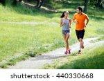 beautiful couple jogging in... | Shutterstock . vector #440330668