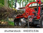 wood chipper making wood chips | Shutterstock . vector #440351536