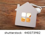 bulb and shape of home on... | Shutterstock . vector #440373982