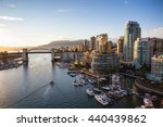 Stock photo view of downtown vancouver and burrard bridge at false creek during sunny sunset 440439862