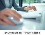 female hand with computer mouse ... | Shutterstock . vector #440445856