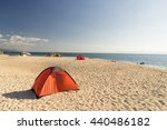 Tents On Beach Of White...