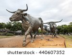 Small photo of DALLAS, USA - APR 9, 2016: Cattle drive sculpture in the city of Dallas. The Statue was gifted by Trammel Crow to the city of Dallas. Texas, United States