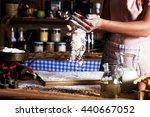 female baker sprinkle the... | Shutterstock . vector #440667052